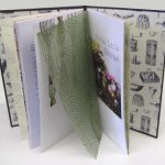 Partly open book showing decorative paper insert