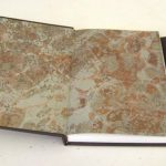 Endpapers add a decorative elememt to a plain chocolate brown covering