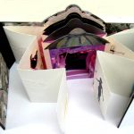 Partly open tunnel book with concertina fold out panels