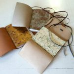 Marbled papers inside leather wrap journals