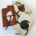 Soft leather wrap journal with designed closure and foil work