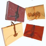 A5 leather journal with decorative leather panels or tooling